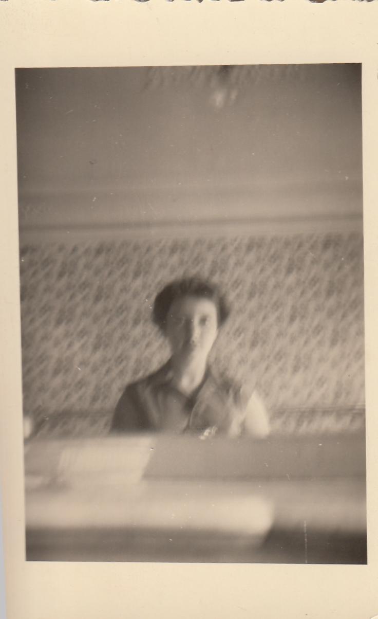 MeInMirrorAtHotelDAlbretParisAugust1955.jpg